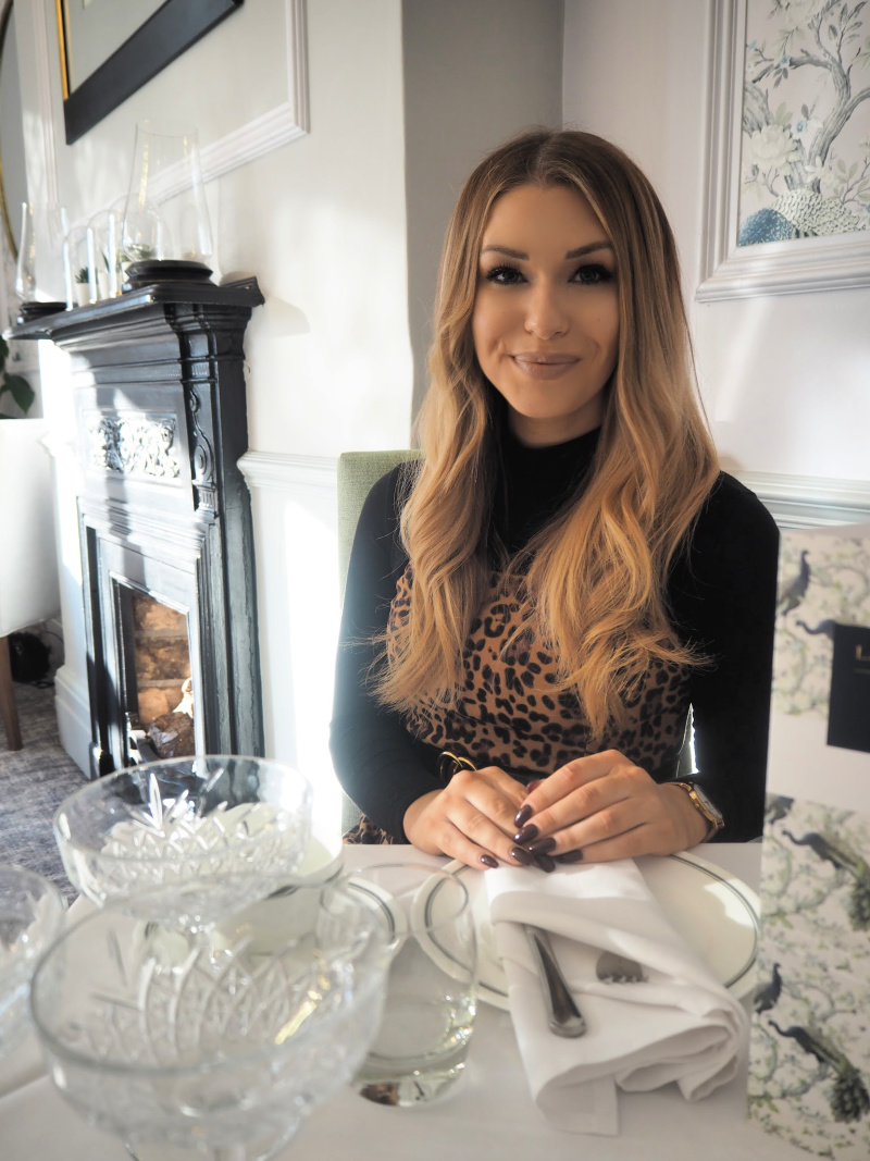 Food blogger reviewing afternoon tea at Laura Ashley, Coventry